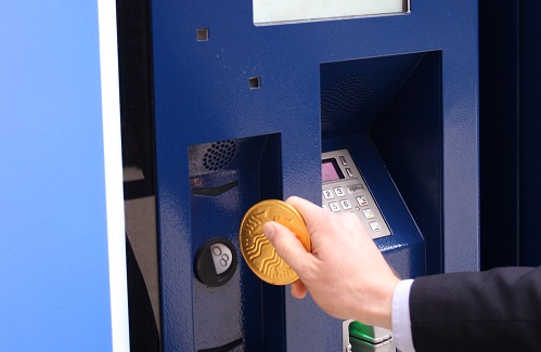 Purchasing a ticket using a chocolate coin