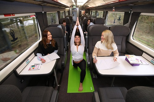 Passengers doing yoga on the train